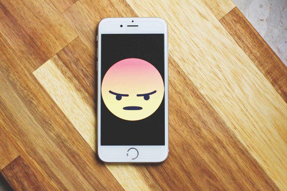 mad emoji on a phone