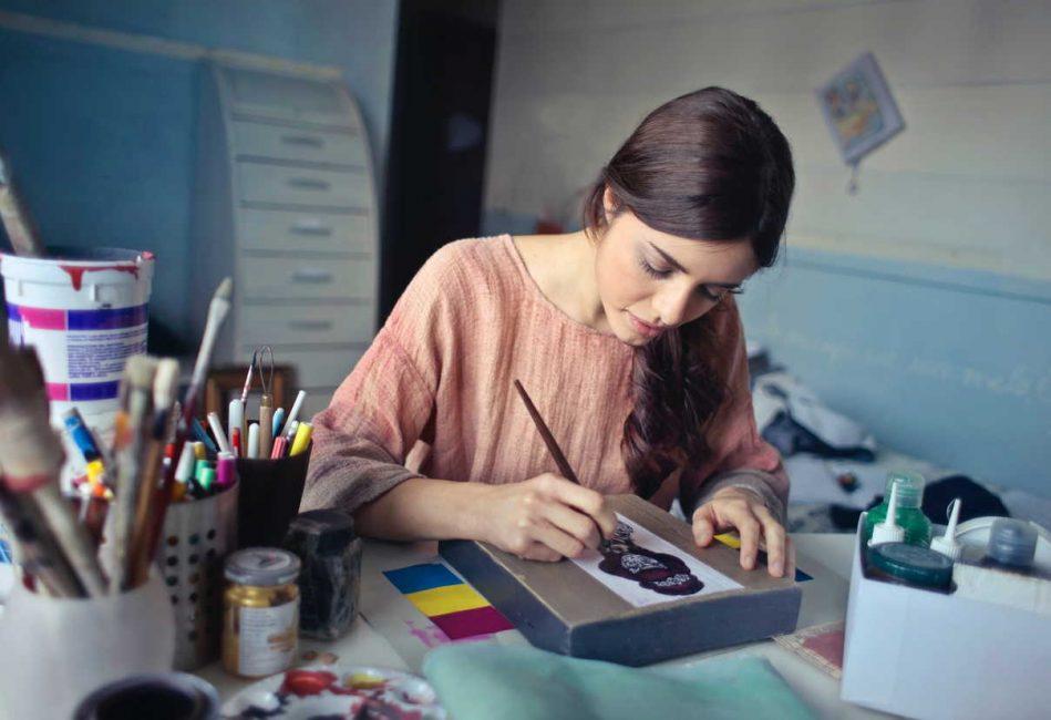 woman making art