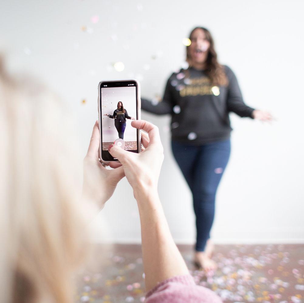 women getting her photo taken